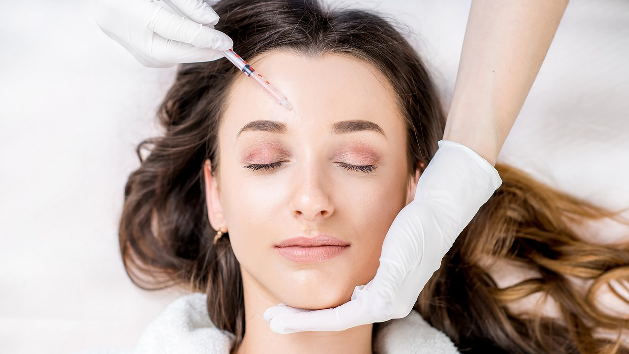 Woman undergoing botox face injection