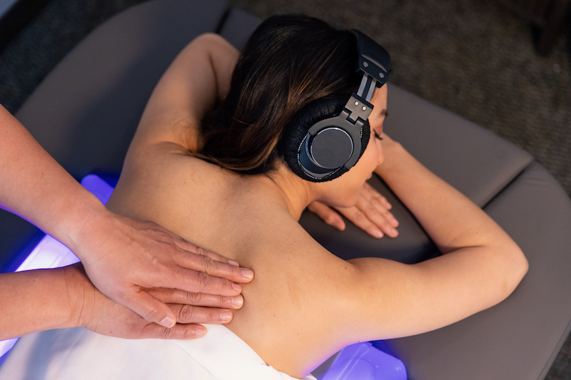 Immersive body massage with headphones